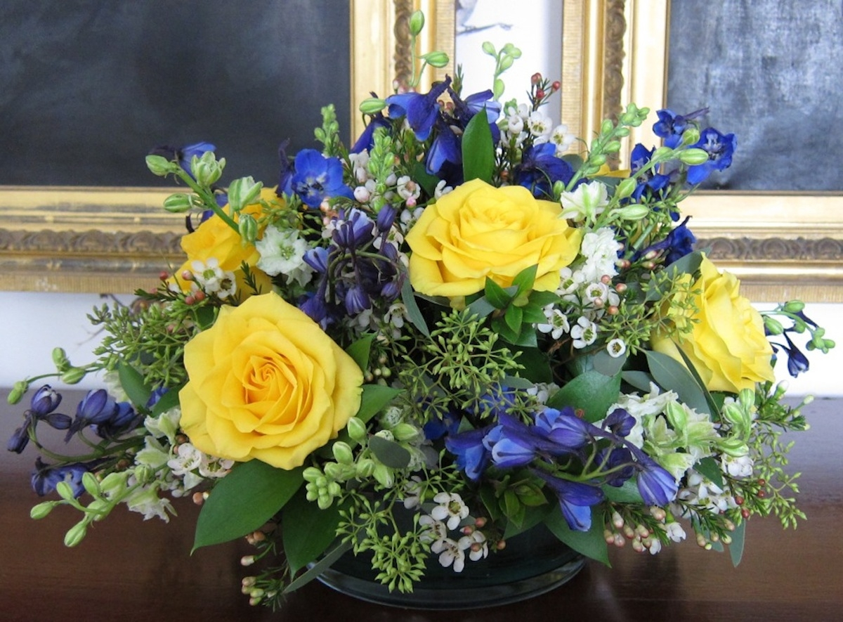 centerpiece-yellow roses and blue delphinium
